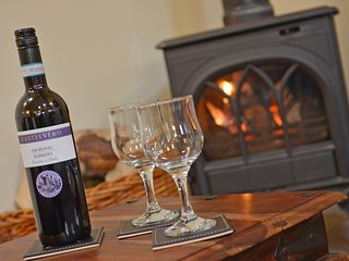 Enjoy a glass of wine by the wood burning stove.