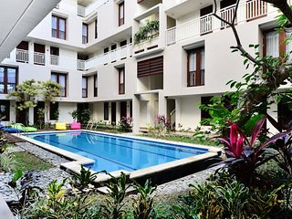 COZY, SWEET, HUSTLE BUSTLE, COMFORTABLE BED WITH BUDGET HOLIDAY KUTA