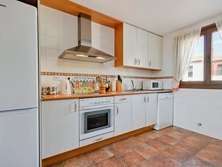 Kitchen with full suite of appliances.
