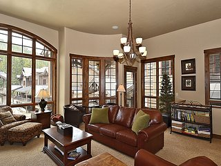 Open floor plan with plush furnishings and lots of light