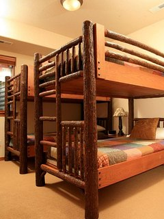 Third bedroom with two sets of bunks on lower level