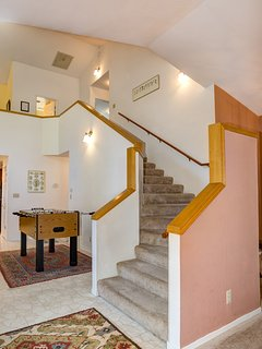 Staircase leading to the Loft, 2 bedrooms, and 3/4 bathroom - Foosball Table in the background