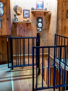 Spiral staircase to lower level bedroom and family room