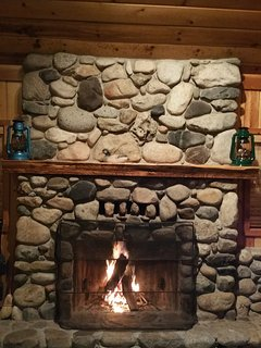 Dramatic river rock fireplace.  (Wood provided in season).
