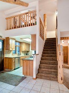 Stairway to loft and upper bedroom