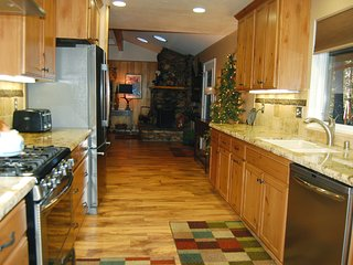 Reverse angle of kitchen with living room in back ground - main floor