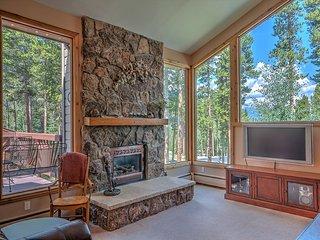 Gorgeous aspen and pine tress surround the house