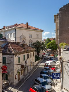 View from bedroom.The street leads to the Diocletian's palace,the cathedral St. Duje,ferry,shops,bar