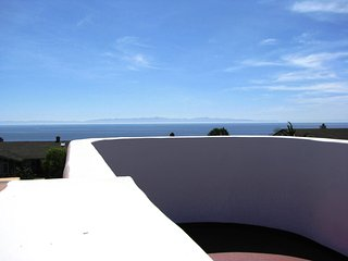 Panoramic ocean views from the rooftop deck