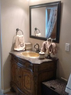 new cabinet with copper sink and faucets...