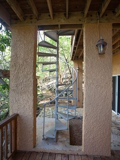 Exterior spiral staircase leads to from upper to lower deck