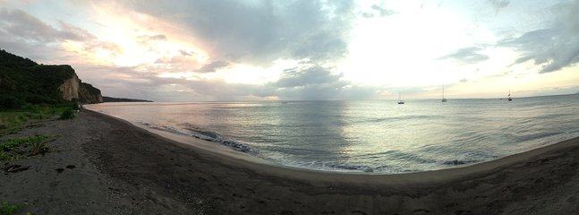 A panoramic view of Isle's Bay Beach and harbor. One of Montserrat's best beaches!