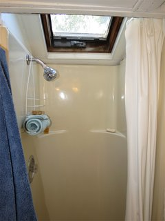 Here's the step-in shower. There's also an outdoor, enclosed shower, perfect for rinsing off after the beach.