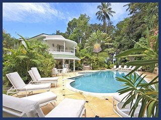 Beautiful beach house is nested within lush tropical gardens and the white sandy shores of our prestigious West Coast beaches, Porters