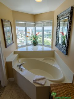 The view from the Captain's master suite tub is spectacular!  Where else can you see the beach from your garden tub and...