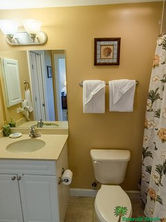 The Tropical Dream Bathroom has an entry from the bedroom and the hall.  It has a large linen closet for extra storage...
