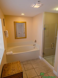 The First Mate's bathroom has a garden tub, walk-in shower, large linen closet and separate dressing area with double...