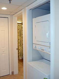 The stack washer and dryer is adjacent to the Crew's Quarters and third bathroom. An iron and ironing board is also...