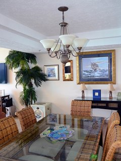 The condo is equipped with tropical dinnerware to use on this fabulous tropical dining table.  You'll love the...