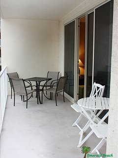Large private balcony with two seating areas.