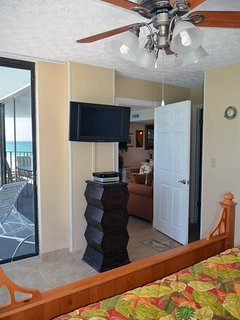 This beach front master suite has a beautiful ceiling fan and a large flat screen TV with DVD player.
