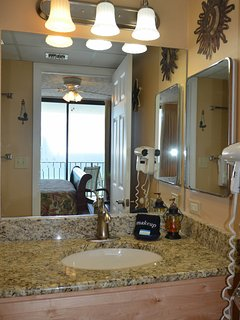 The Captain's Jade Stateroom Suite's Bathroom has granite counter tops and maple cabinetry.  You'll find a hair dryer...