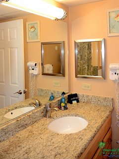 Crew's Quarters Bathroom has high end granite counter tops and maple cabinetry with plenty of storage.  There is a hair...