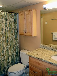 The Crew's Quarters Bathroom has a combination tub/shower with shower massage.