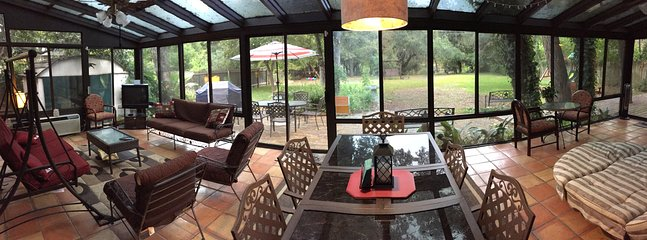 Huge sunroom for relaxing, dining and  perfect to  watch the deer. AC /Heated for your comfort.