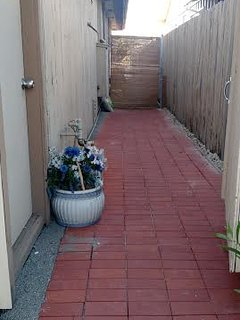 When you enter the east gate, go through this newly remodeled side yard to go to the backyard.