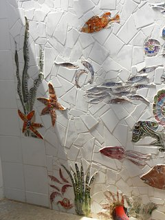 Sculptures with fish on the shower walls off the covered main deck