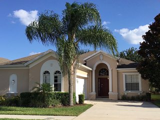 Beautiful 4 bedroom and 3 baths with 2 master suites, on guarded community.