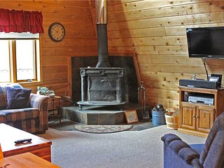 Located at Base of Powderhorn Mtn in the Western Upper Peninsula, An Intimate Little Home with Free-Standing Fireplace, Ironwood