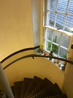 Spiral stairwell to first floor.