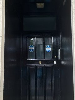 Front door with secure buzzer entry system.