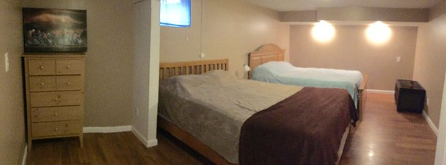 Lower level bedroom with 2 QUEEN beds and a walk-in closet