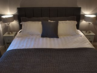 Super king size bed with luxury duck feather bedding and Egyptian cotton bedlinen.