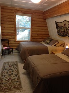 upstairs bedroom with a queen bed and a full bed