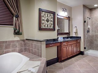 The master bathroom has a Jacuzzi tub and a walk-in shower.
