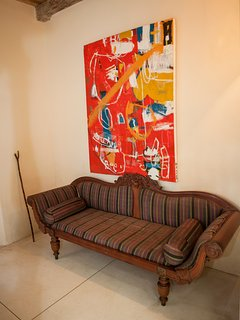 An antique sofa in one of our double rooms