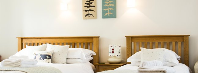 Ground floor is the twin room with kingsize bed and single bed and ensuite bathroom.