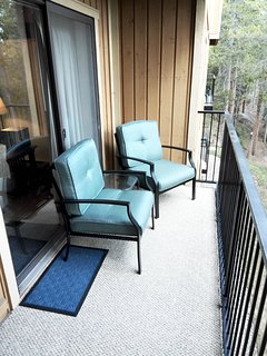 Comfortable warm-weather outside seating on our wooded deck.