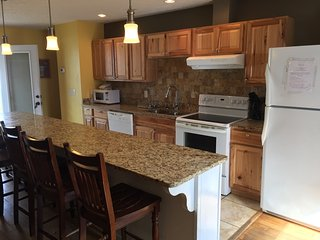 Open Kitchen with Granite and Maple Cabinets