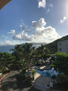 View out of the side window of our balcony. That's St. John center and Tortola on the left.