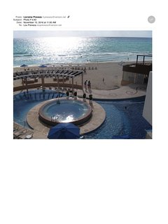 View of pools and the ocean near sunset