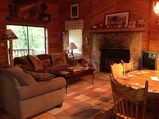 Cherokee Living Room with wood burning fireplace