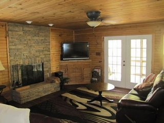 Living Room with fireplace, large flat screen TV, WIFI and more