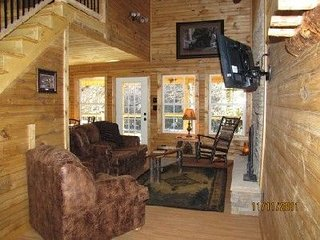 River Escape Living Room with wood burning fireplace