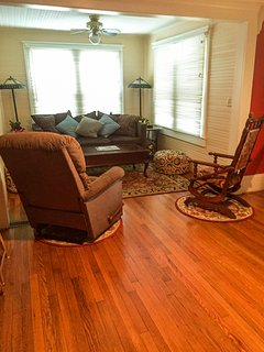 Livingroom with wide Sherrill sofa, Lazyboy recliner and antique rocking chair