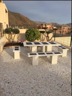 Solid outdoor table and benches for those outdoors meals